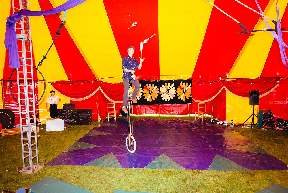 unicycling circus performer
