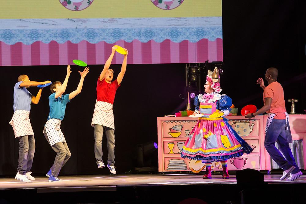 circus performers juggling plates
