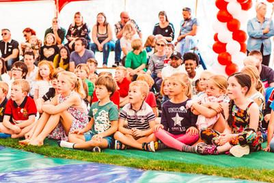 Children watching a circus show