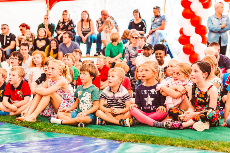Children watching a circus show