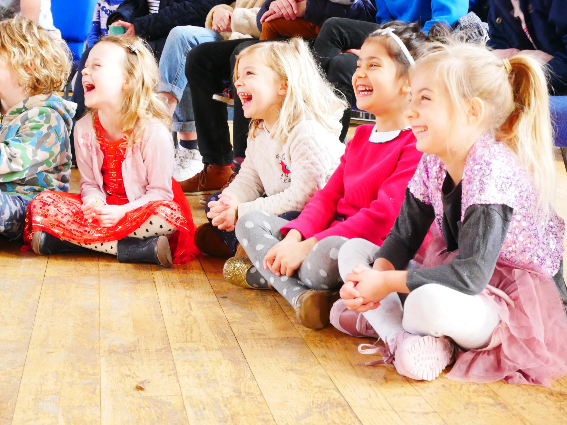 children enjoying the show