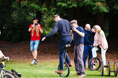 employees learning to unicycle