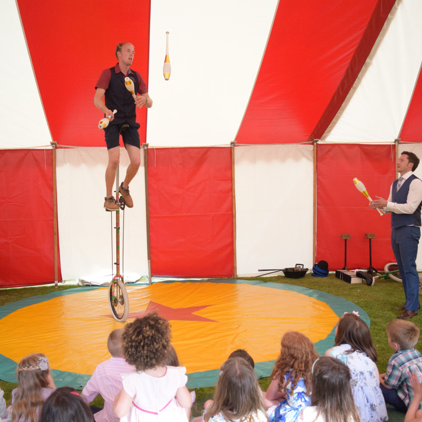 The 7 foot giraffe unicycle is a popular traditional finale and I juggle 5 clubs on it.