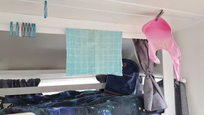 YOU CAN NEVER HAVE TOO MANY PLACES TO HANG THINGS IN A CARAVAN
