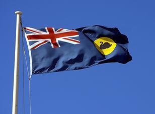 The Western Australian Flag against a bl