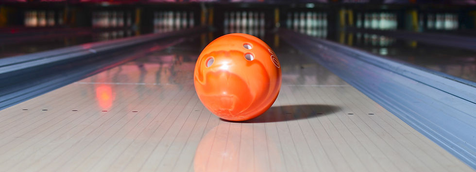 Orange bowling ball on the track. Active
