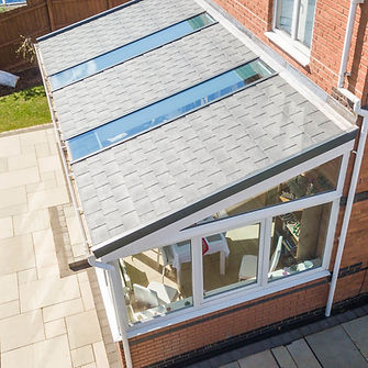 Lean to conservatory with solid tiled roof