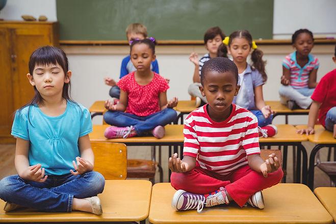 YIP Children Meditating on Desks.jpg