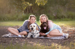 twin sisters with their labradors