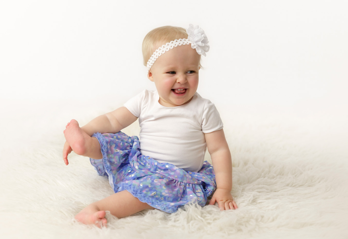 12 month girl playing