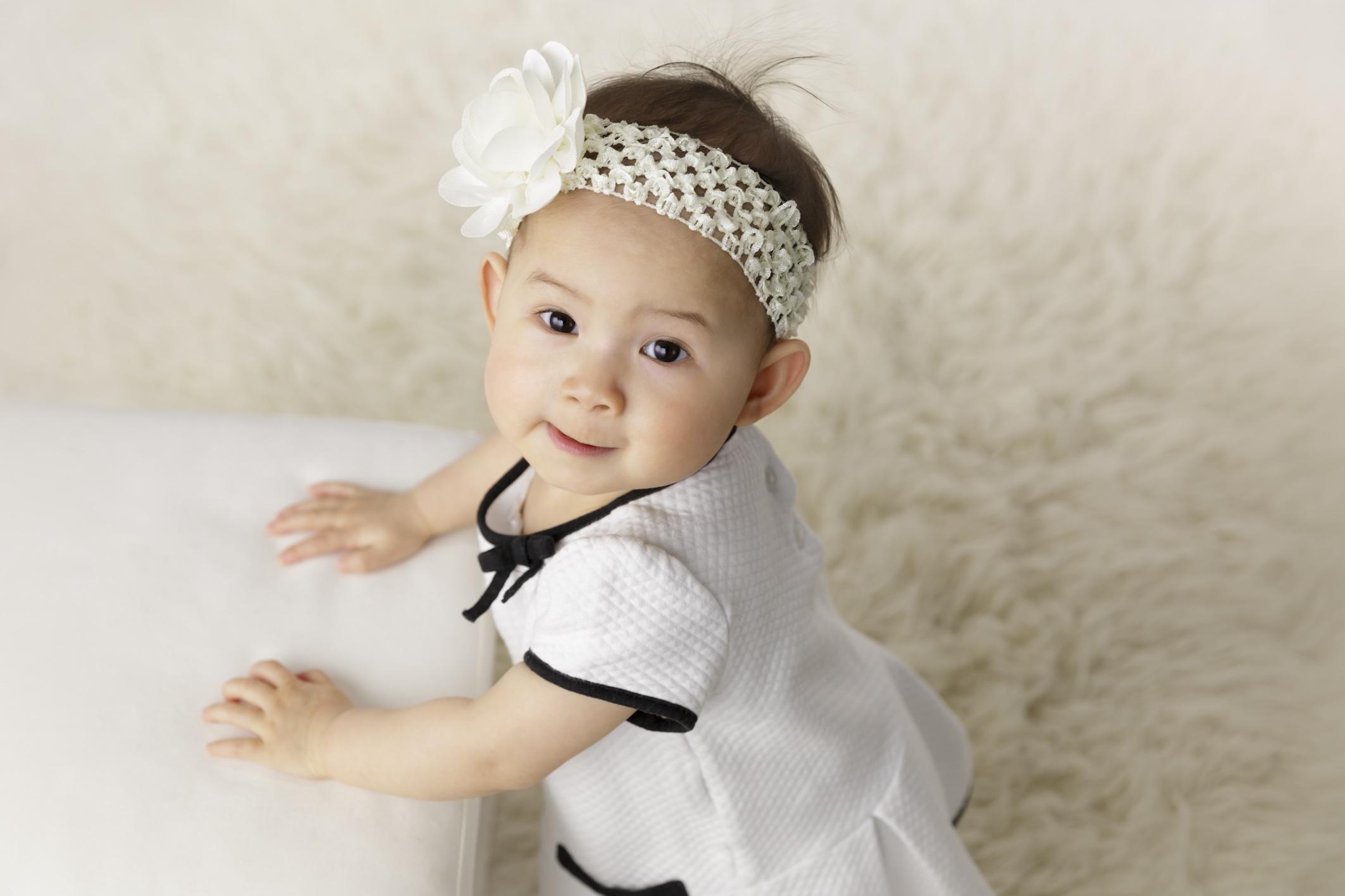 one year old girl wearing headband