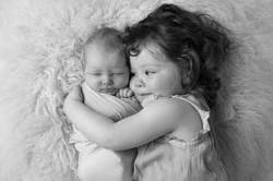 cuddling baby sister