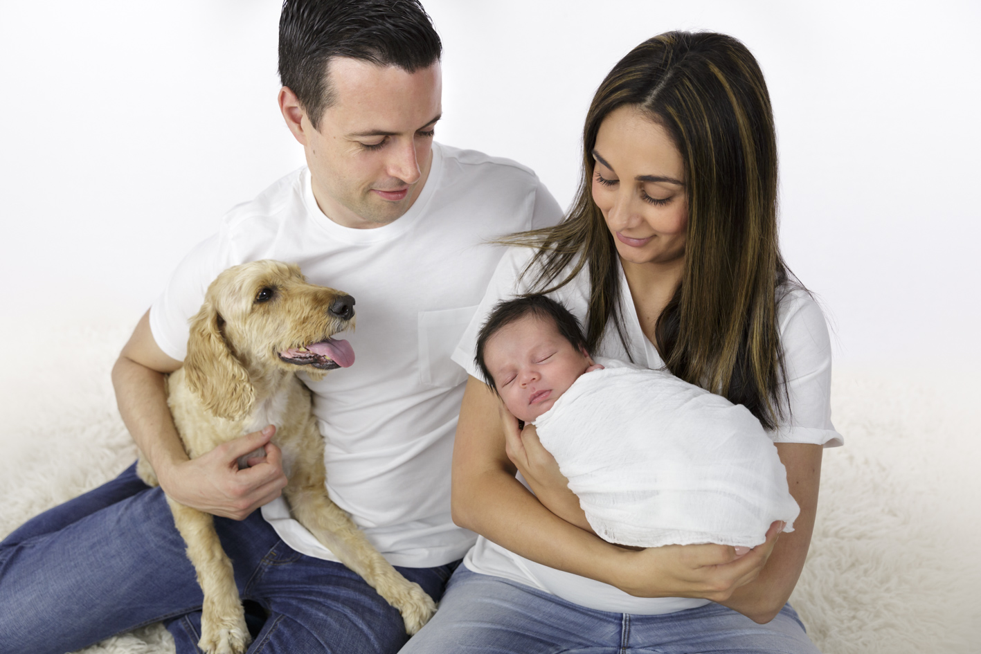 baby boy with parents and dog