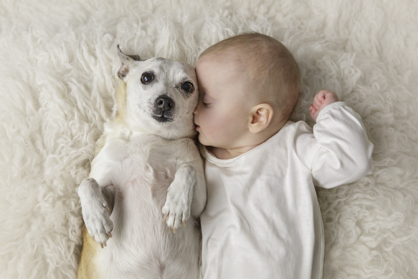 baby with beloved pet dog