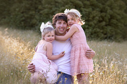 Dad and daughters Spring time