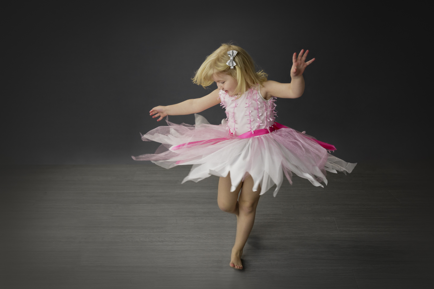 girl twirling in dress