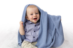 10 month baby playing with blanket