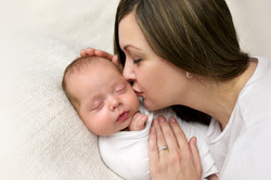 stunning mother kissing 4 month son