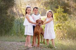 3 children with beloved dog