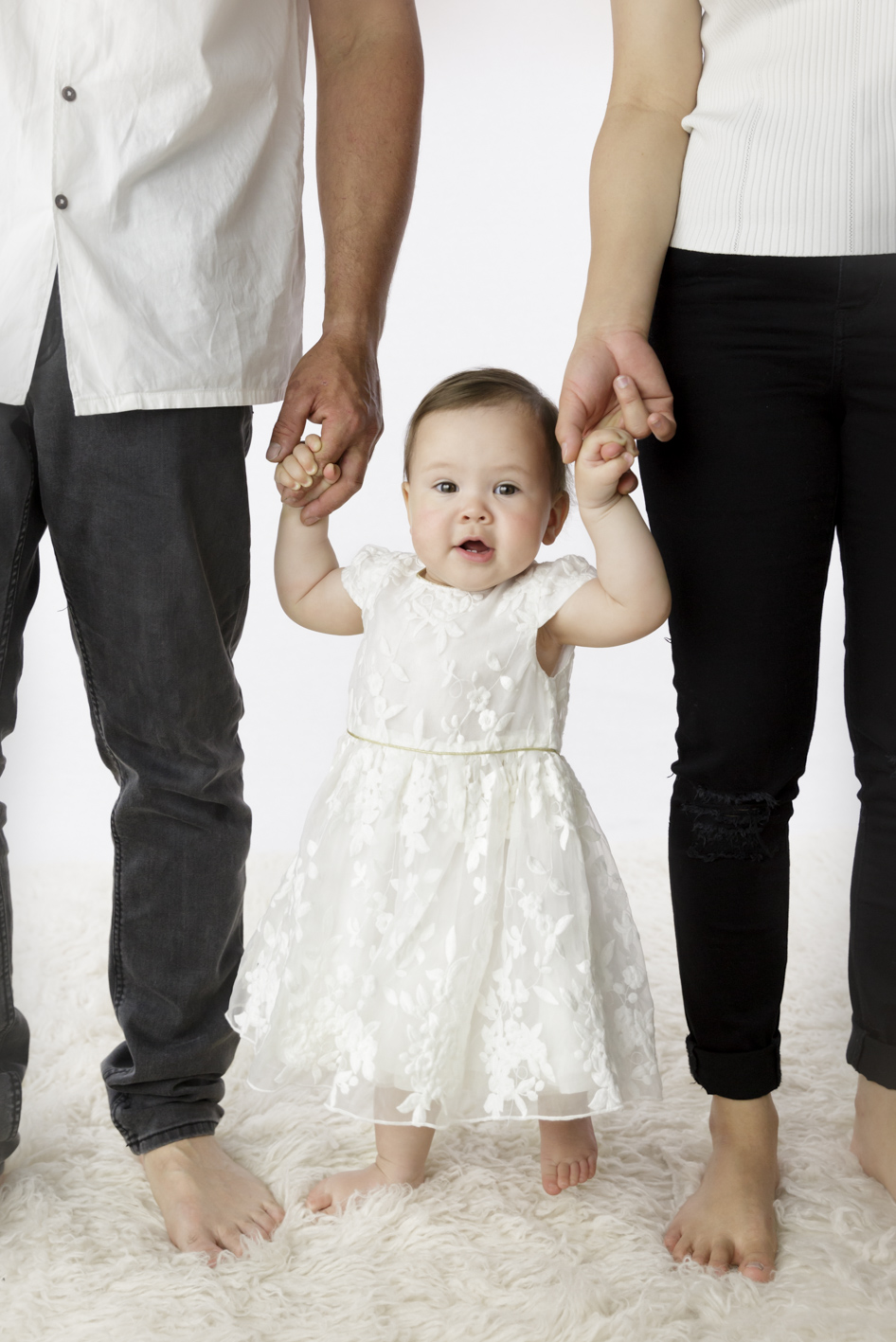 one year old girl with parents