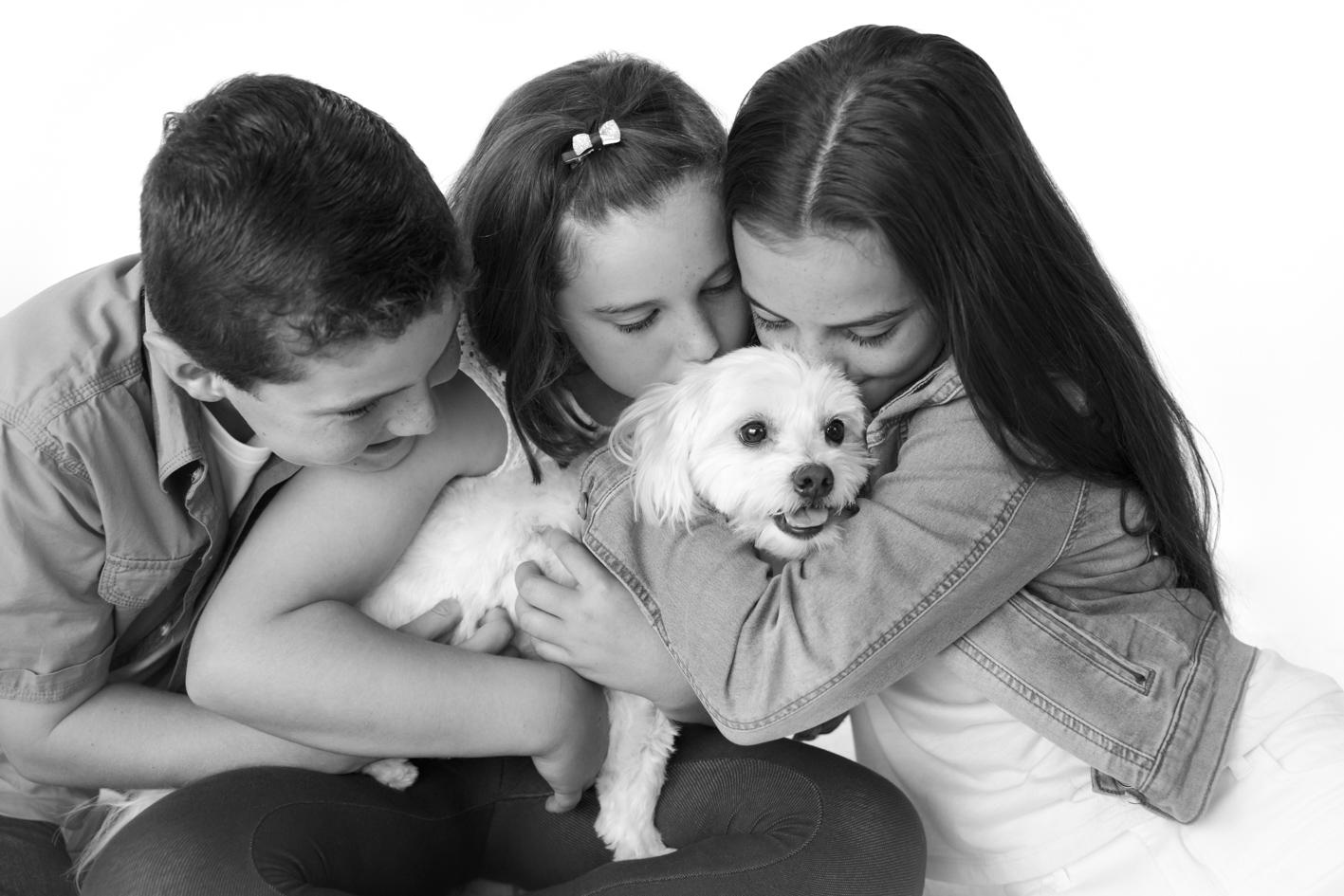 kids hugging dog