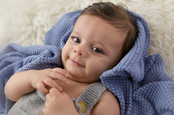 baby boy with blue blanket