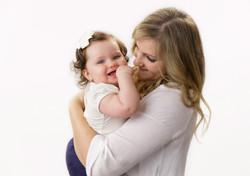 mother cuddling baby girl