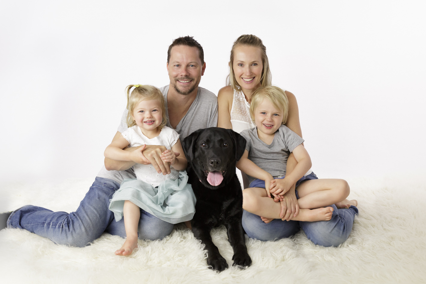 family portrait with Labrador dog