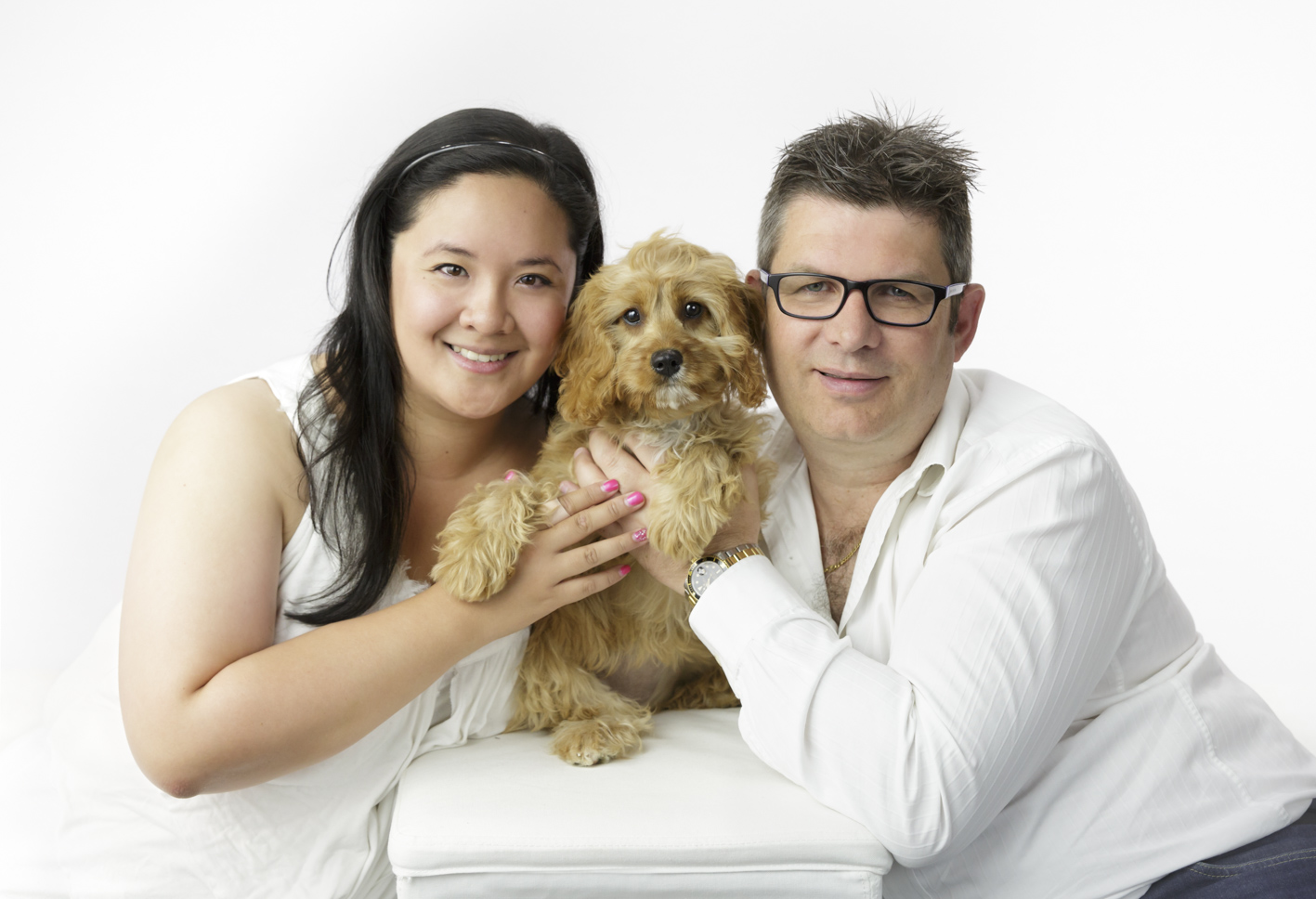 couple and their dog studio portrait