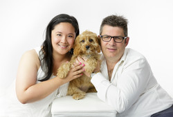 couple and their dog studio portrait