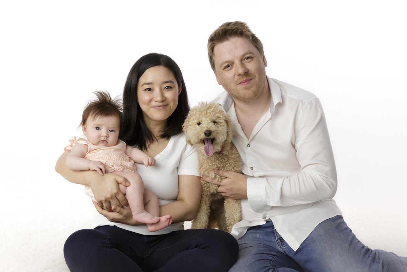 family baby photos including dog