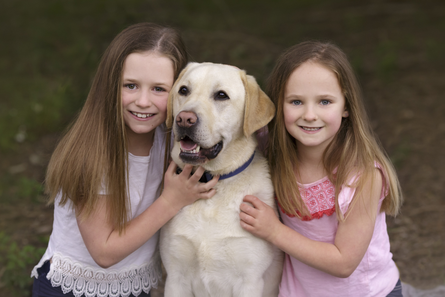 sisters with their Labrador