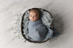 baby boy in basket prop