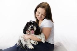 owner cuddling dog