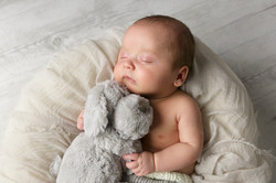 sleeping baby with teddy