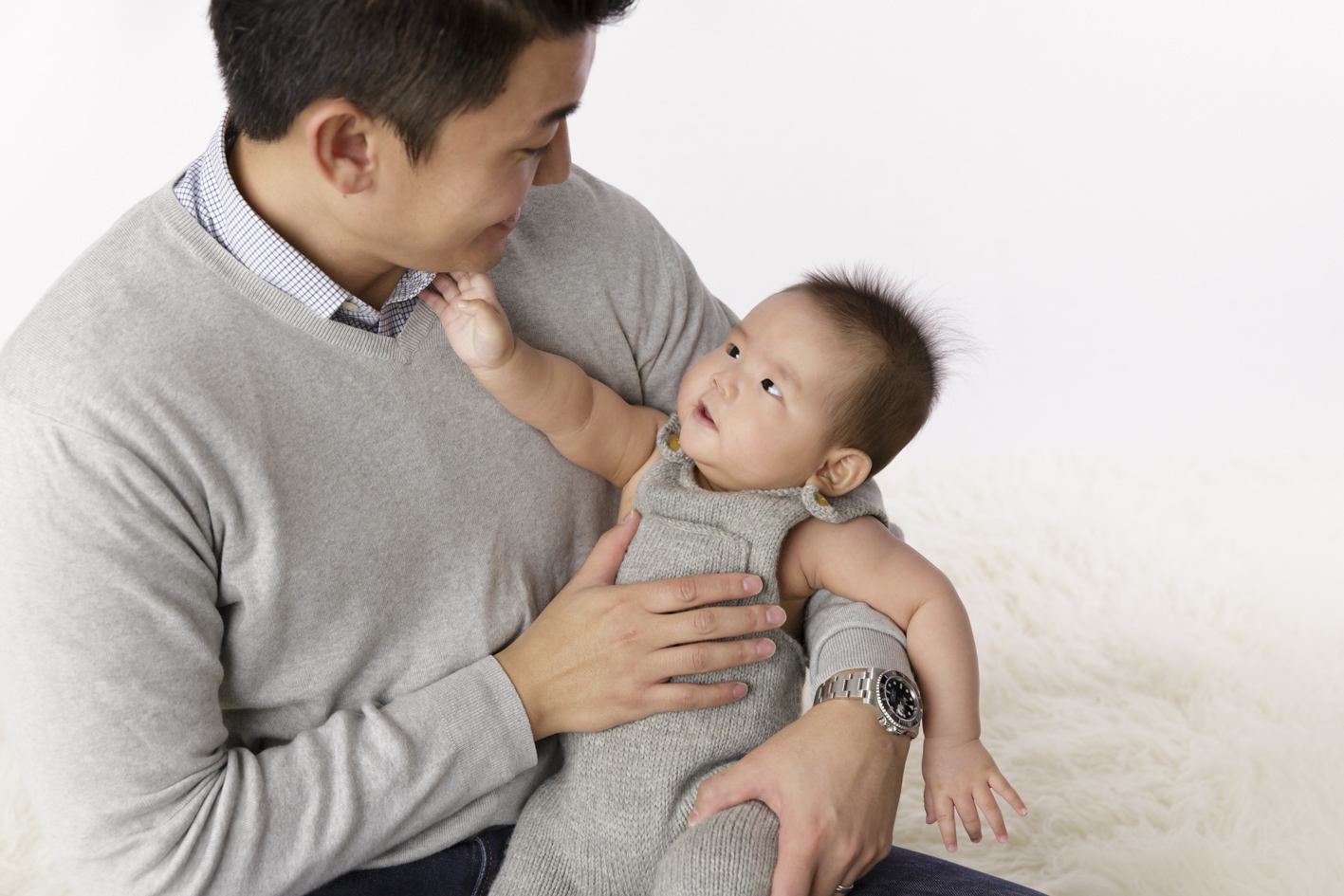 baby touching dads face