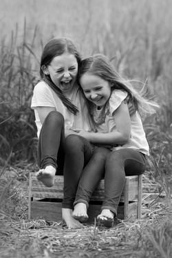 sisters having fun outdoor portrait