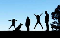 silhouette family with dog