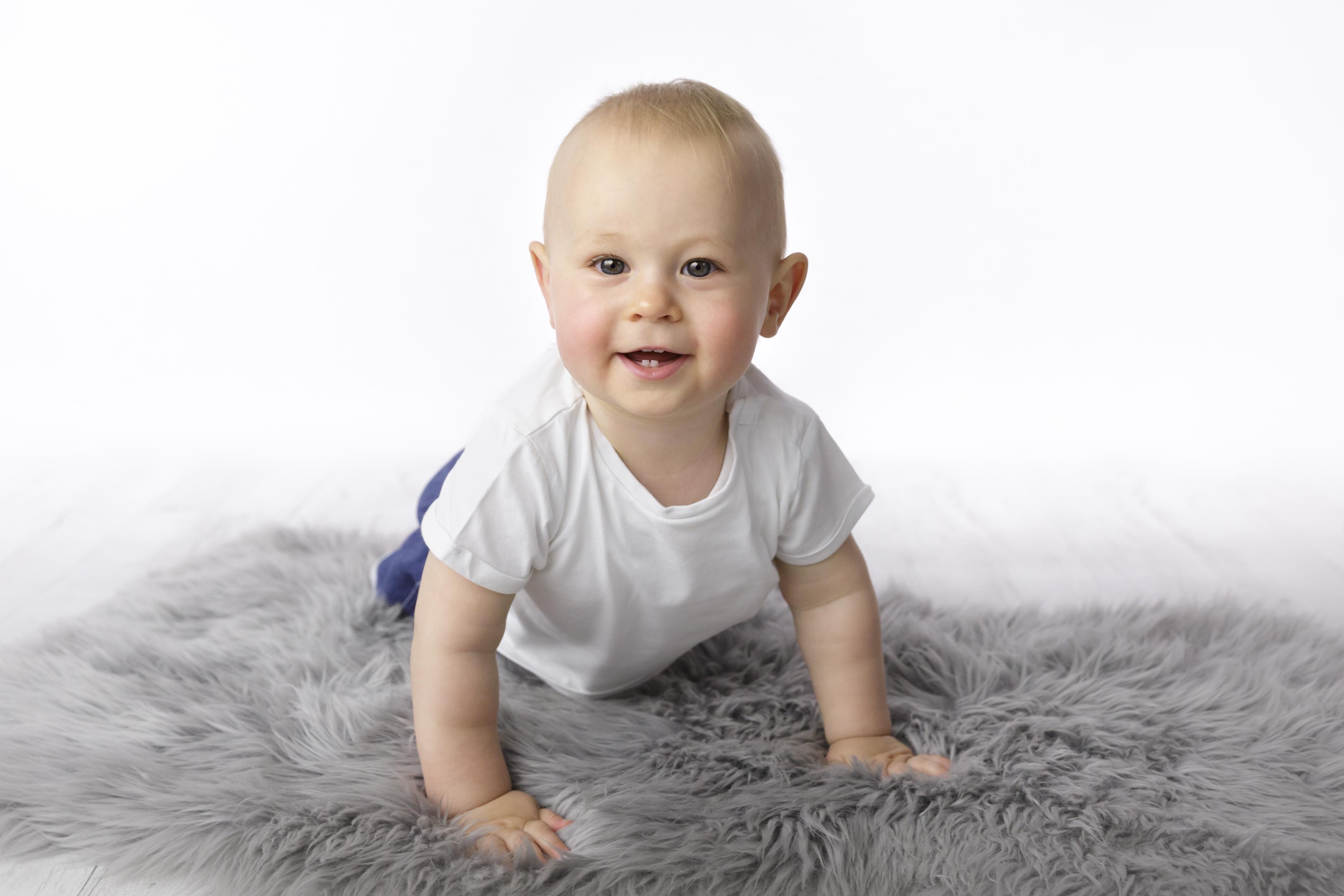crawling one year old boy