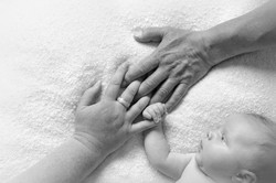 family hands with baby