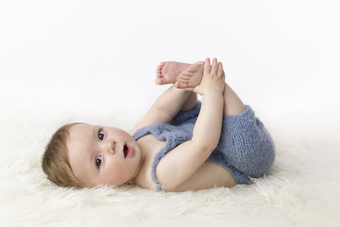 baby boy grabbing feet