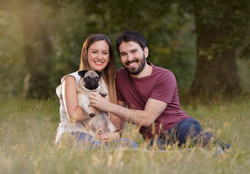 sunset couple and their dog