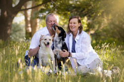 happy dogs with couple