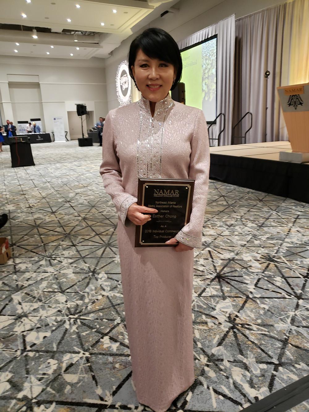Esther Chong accepting 2018 NAMAR #1 Commercial award