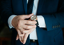 businessman looking at his watch on his