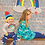 Baby wearing weather leggings and rainbow top with little girl wearing unicorn dress