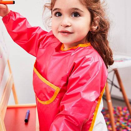 Child painting wearing the B.Box Smock Bib in colour Strawberry Shake