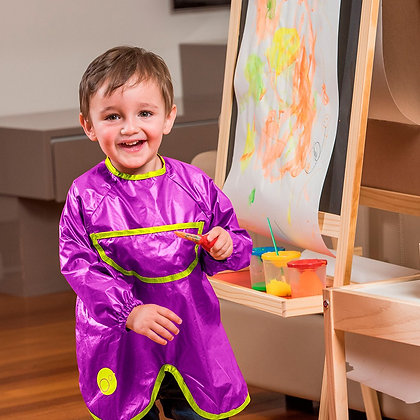 A child painting in a B.Box Smock Bib in colour Passion Splash