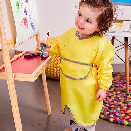 Child painting wearing the B.Box Smock Bib in colour Lemon Sherbet