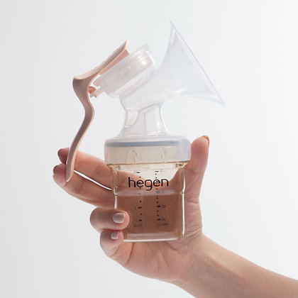 a hand holding the Hegen Manual Breast Pump